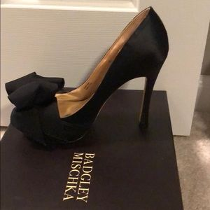 Black satin Peep toe pumps